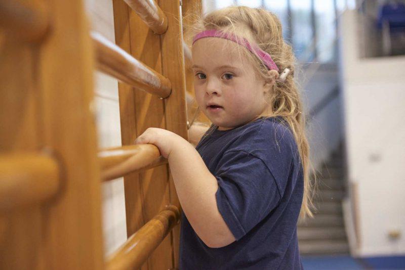 child on wallbars